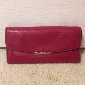 COACH magenta wallet.